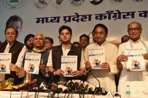 Madhya Pradesh Congress president Kamal Nath along with campaign committee chief Jyotiraditya Scindia and former chief minister Digvijaya Singh, Suresh Pachouri and Rajendra Singh release party election manifesto for the upcoming Madhya Pradesh Assembly elections at PCC headquarters in Bhopal on Saturday.