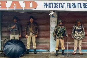 Security personnel stand guard during curfew after a senior BJP leader Anil Parihar (52) and his brother Ajeet (55) were killed by suspected militants in Kishtwar, Jammu.