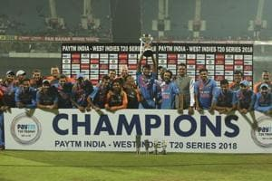 Members of the Indian cricket team pose with the winners trophy after their win in the third and last Twenty20 international cricket match against West Indies in Chennai.