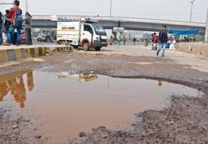 Potholed road near Subhash Chowk, in Gurugram, India, on Saturday, November 10, 2018