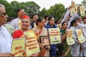 Trinamool Congress and Samajwadi Party members hold placards during a protest over the Assam NRC issue at Parliament House in New Delhi on July 31.