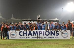 Indian players pose after winning the T20I series against West Indies.