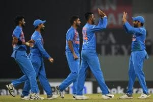 Indian captain Rohit Sharma (R) celebrates with teammates after the wicket of unseen West Indies batsman Fabian Allen during the second T20 cricket match between India and West Indies