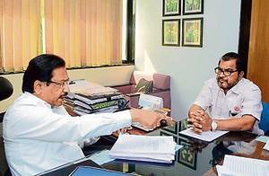 Swabhimani Shetkari Sanghatana leader Raju Shetti (R) meet Sugar commissioner Sambhaji Kadu Patil on Monday.