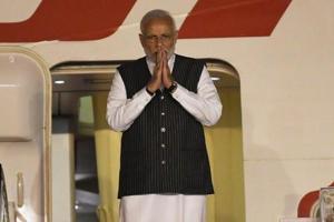 Prime Minister Narendra Modi embarks on the plane to leave for Singapore on November 13.