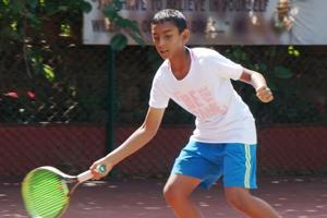 Arnav Paparkar in action at the super series under-12 tennis tournament at Ravine hotel tennis courts in Panchgani on Monday.