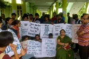 File picture of students of Satyajit Ray Film and Television Institute during the gherao of its director Debamitra Mitra (in green sari) in October 2017 to protest the expulsion of 14 female students for refusing to move to a new women's hostel.