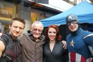 Jeremy Renner, Scarlett Johansson and Chris Evans pose with Stan Lee.