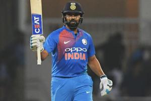 Rohit Sharma raises his bat after scoring a half centur during the second T20 cricket match between India and West Indies.