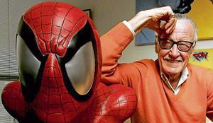 FILE: Stan Lee, founder of Marvel Entertainment Inc., poses for a photograph with a life size model of his superhero Spider-Man. Photographer: Jonathan Alcorn/Bloomberg