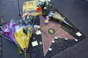 A wreath and other memorabilia adorn the star of Stan Lee on the Hollywood Walk of Fame, Monday, Nov. 12, 2018, in Los Angeles. Lee, the creative dynamo who revolutionized the comic book and helped make billions for Hollywood by introducing human frailties in superheroes such as Spider-Man, the Fantastic Four and the Incredible Hulk, died Monday. He was 95.