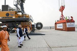 Prime Minister Narendra Modi looks on at India