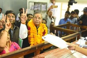 MLA and former BJP minister Ghanshyam Tiwari makes victory sign during filing of nomination for Rajasthan assembly polls, in Jaipur, on Monday, 12 November 2018.