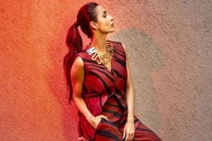 Malaika Arora wore the animal print trend to perfection, pairing the look with a metallic choker and the perfect red pout. (Instagram)