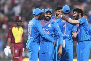 Indian T20 cricket captain Rohit Sharma (2L) celebrates with teammates the wicket of West Indies cricketer Shai Hope during the first T20 cricket match between India and West Indies at the Eden Gardens