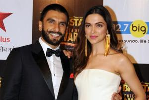 (FILES) Bollywood actors Ranveer Singh (L) and Deepika Padukone had their mehendi and sangeet functions on Tuesday.