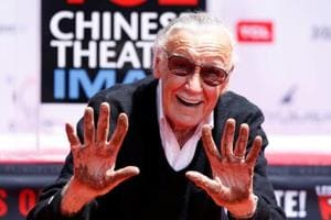 Marvel Comics co-creator Stan Lee shows his hands after placing them in cement during a ceremony in the forecourt of the TCL Chinese theatre in Los Angeles.