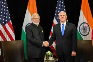 Prime Minister Narendra Modi with the US vice president Mike Pence, on the sidelines of East Asia Summit, in Singapore on Wednesday.