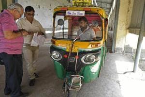 A transport inspector checks vehicles at Regional Transport Office (RTO) office in Burari, New Delhi.