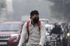 A man wears a pollution mask amid heavy smog, in Noida, on Tuesday, November 13,2018.