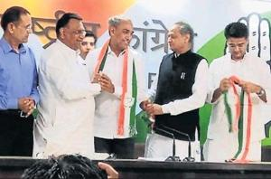 BJP MP Harish Meena joins the Congress in the presence of state president Sachin Pilot and former CM Ashok Gehlot, in Delhi on Wednesday.