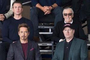 Clockwise: Robert Downey Jr, Chris Evans, Stan Lee and Marvel president Kevin Feige pose at a special Marvel event.