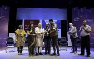 Anuk Arudpragasam (centre, in brown) being handed the DSC Prize 2017 at the Dhaka Literature Festival.