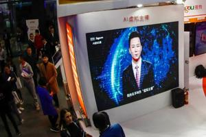 In this photo taken on November 7, 2018, a screen shows an artificial intelligence (AI) news anchor introducing himself at the Light of Internet Expo during the 5th World Internet Conference in Wuzhen in China