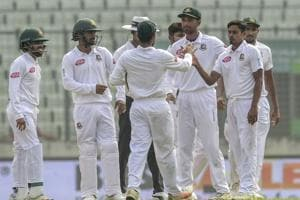 Bangladesh cricketer Taijul Islam (2nd L) celebrates with his teammates after the dismissal of the Zimbabwe cricketer Sikandar Raza during the fifth day )