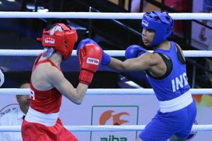 Indian boxer Manisha Moun in action during her bout against Christian Cruz.