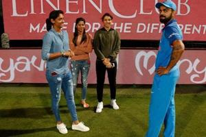 File photo of Virat Kohli interacting with women cricketers Harmanpreet Kaur and Smriti Mandhana.