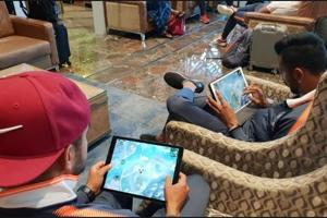 Manish Pandey (L) and Krunal Pandya playing PUBG at the airport.