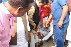 UP cabinet minister Rajendra Pratap Singh was caught on camera getting his sandals cleaned by his staff.