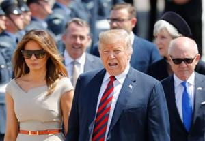 US President Donald Trump (C) and US first lady Melania Trump (L).