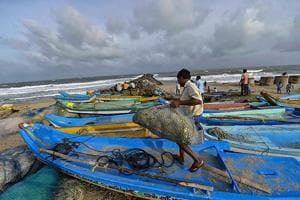 Fishermen dock their boats as a precautionary measure ahead of the arrival of cyclone Gaja, which intensified into a severe cyclonic storm and made landfall in he wee hours of Friday.