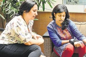 (From left) Protima Sharma and Smriti Gupta discuss regarding their campaign page in Pune, on Tuesday.