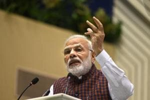 Prime Minister Narendra Modi dared the Congress on Friday to choose someone from outside the Gandhi family as its president for five years, saying he would then accept that India's first PM Jawharlal Nehru truly left behind a legacy of democracy.
