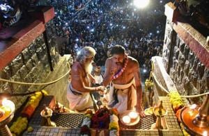 Amid a bitter standoff between the state government and protesters over the entry of women, the Sabarimala temple in Kerala opened for 64-day annual pilgrimage season on Friday