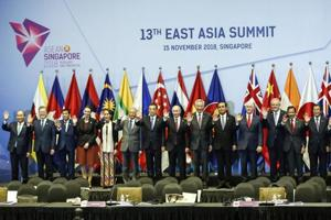 East Asia Summit leaders pose for a group photo during the 13th East Asian Summit Plenary on the sidelines of the 33rd ASEAN summit in Singapore, Thursday, Nov. 15, 2018. From left to right are Vietnam