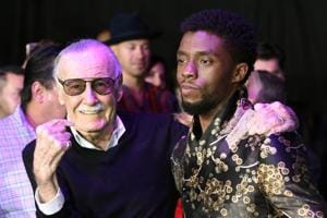 Comic book legend Stan Lee, left, creator of the Black Panther superhero, poses with Chadwick Boseman, star of the Black Panther film.