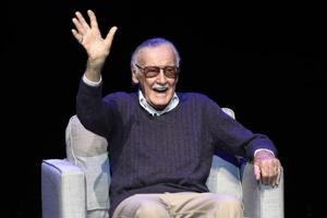 (File) Stan Lee waves to the audience after being introduced onstage at the Extraordinary: Stan Lee tribute event at the Saban Theatre in Beverly Hills, California.