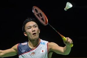 Kento Momota of Japan hits a return against Taiwan