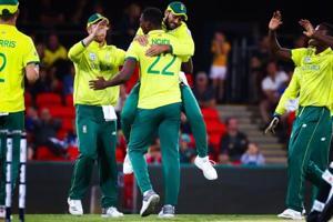 Lungi Ngidi of South Africa is embraced by Tabraiz Shamsi after dismissing Australia