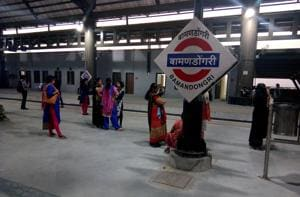 Women commuters wait for a train at the newly inaugurated Bamandongri railway station. They have raised concerns about their safety, especially when they travel at night.