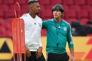 A file photo of German defender Jerome Boateng (L) and German coach Joachim Loew.