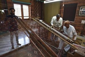 Two generations of a Salvi family work the loom to create the double ikat Patola, that is made only in Patan.