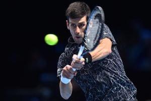 Novak Djokovic returns against Croatia