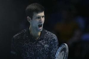 Novak Djokovic of Serbia celebrates winning a point against Kevin Anderson of South Africa in their ATP World Tour Finals singles tennis match at the O2 Arena in London, Saturday Nov. 17, 2018