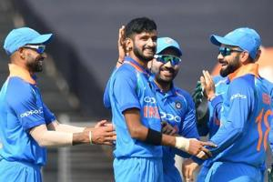 File - India bowler Khaleel Ahmed (C) celebrates with captain Virat Kohli (R), Rohit Sharma and Shikhar Dhawan (L) after taking a wicket.