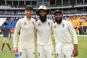 England spinners Jack Leach (l) Moeen Ali (c) and Adil Rashid celebrate victory after Day Five of the Second Test match between Sri Lanka and England at Pallekele Cricket Stadium)